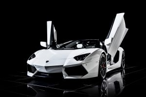 Lamborghini Aventador, white on black background by Birmingham car photographer Paul Ward